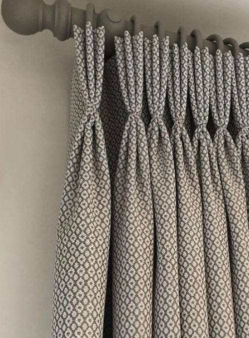 Patterned-curtains-on-rail